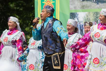 KAZAN, RUSSIA - JUNE 23, 2018: Traditional Tatar festival Sabantuy - Folk national tatar ensemble songs and dances on stage Editorial