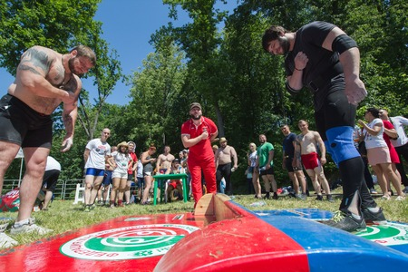 KAZAN, RUSSIA - JUNE 23, 2018: Traditional Tatar festival Sabantuy - Strong muscular men bow to each other before the battle outdoors