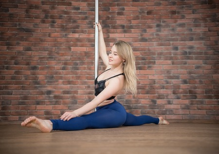 Girl posing in a pole dance studio
