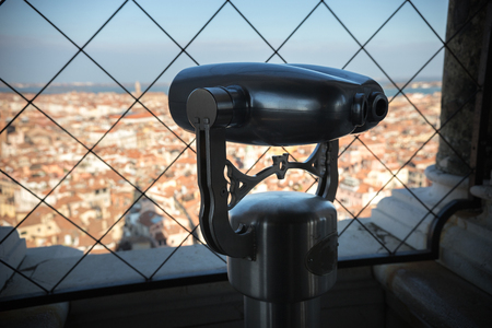 Binoculars aimed at the city in one of the towers