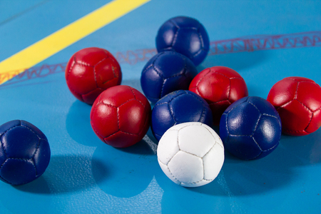 Boccia. Close up of little balls for playing boccia. Tricolor.