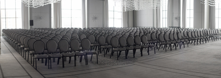 Empty conference hall. Empty rows of chairs Stock Photo