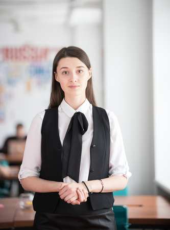 Young business lady standing in the office in a work clothes Stock Photo