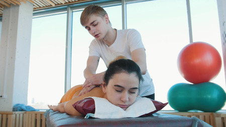 A young pretty woman receiving a massage