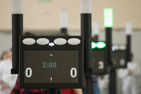 Fencing tournament. A counting electronic device standing in the hall