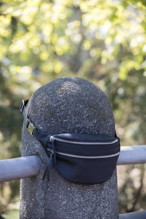 A traveler left their waist bag on the railing protrusion Stok Fotoğraf