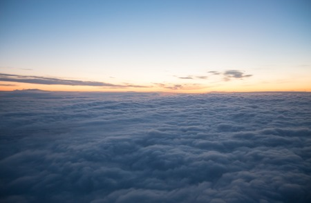 View from plane window - blue sky with white clouds, wide angle Stock Photo