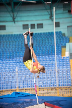 A female jumper in the stadium - pole vault