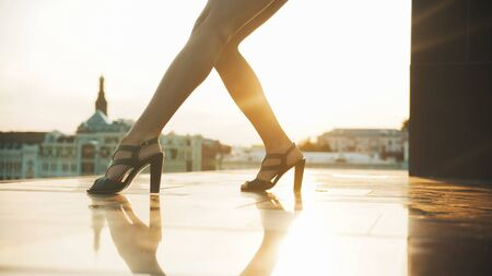 Skinny attractive legs of young woman dancer in high heels