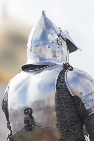 A man knight on the battlefield in iron helmet