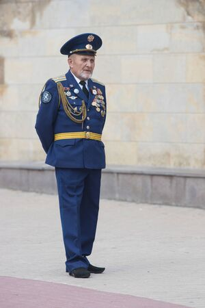 RUSSIA, KAZAN 09-08-2019: An army major standing on the street while wind instrument parade Editorial