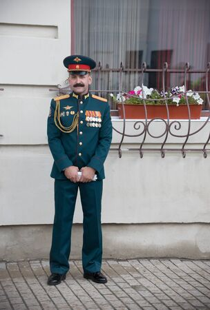 RUSSIA, KAZAN 09-08-2019: Colonel General standing on the street while wind instrument parade