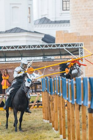 BULGAR, RUSSIA 11-08-2019: Knight Tournament at the medieval festival outdoors - participants in full armor aiming in the opponent with a wooden spear