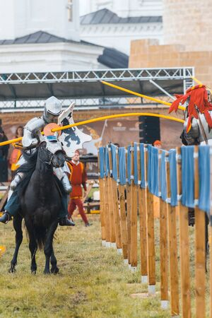 BULGAR, RUSSIA 11-08-2019: Knight Tournament at the medieval festival - participants in full armor balk in the opponent with a spear