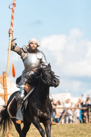 BULGAR, RUSSIA 11-08-2019: A man knight riding a horse and lifts up the spear