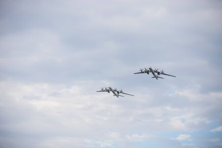 Two military long range bomber aircrafts flying in the sky Stockfoto - 129774427