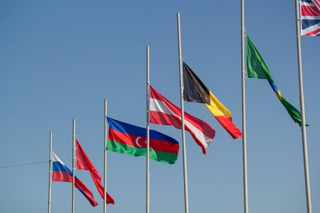 Flags of the world countries blowing in the wind. Mid shot