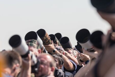 Photographers taking photos of an airplanes - lenses pointing up 스톡 콘텐츠