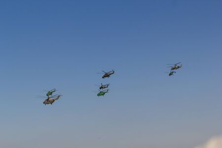 Several military helicopters flying in the summer sky Stok Fotoğraf