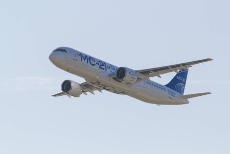 30 AUGUST 2019 MOSCOW, RUSSIA: A passenger plane flying in the sky - AIRBUS MC-21 에디토리얼