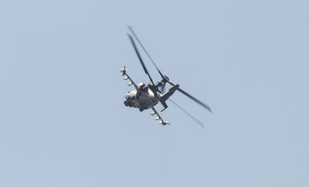 29 AUGUST 2019 MOSCOW, RUSSIA: Russian Air Force - A military helicopter with two pair of blades flying in the sky 에디토리얼