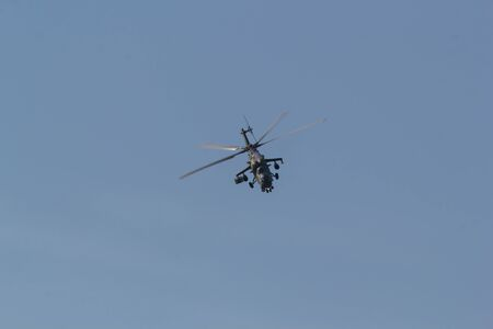 29 AUGUST 2019 MOSCOW, RUSSIA: A military small helicopter flying in the sky - front view