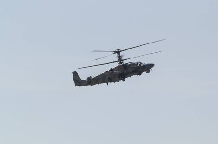 29 AUGUST 2019 MOSCOW, RUSSIA: Russian Air Force - A military dark helicopter with two pair of blades flying in the sky 에디토리얼