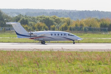30 AUGUST 2019 MOSCOW, RUSSIA: A small passenger plane with side propellers riding on the runway 에디토리얼