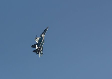 29 AUGUST 2019 MOSCOW, RUSSIA: A light green military fighter jet flying up in the sky