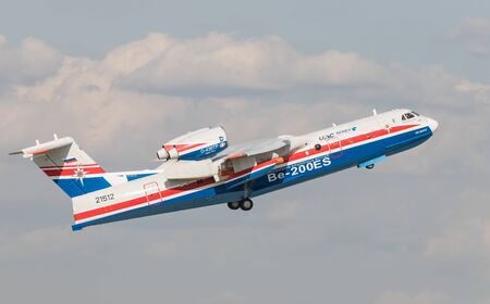 30 AUGUST 2019 MOSCOW, RUSSIA: A passenger plane speeding up flying up in the sky - UAR BE-200ES 에디토리얼