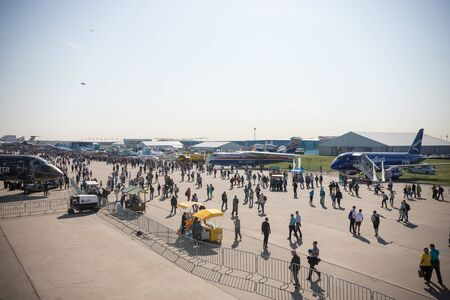 30 AUGUST 2019 MOSCOW, RUSSIA: an outdoors aircraft exposition - people walking and looking at the planes