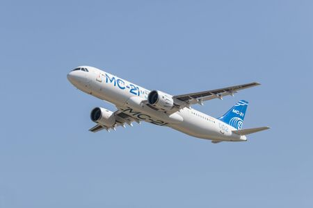 30 AUGUST 2019 MOSCOW, RUSSIA: A passenger plane flying in the clear blue sky - AIRBUS MC-21