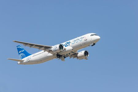 30 AUGUST 2019 MOSCOW, RUSSIA: A passenger plane flying in the clear sky - AIRBUS MC-21 300
