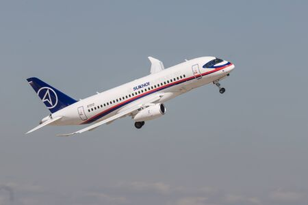 30 AUGUST 2019 MOSCOW, RUSSIA: A passenger plane flying in the overcast sky - SUKHOI SUPERJET100