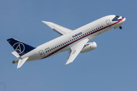 30 AUGUST 2019 MOSCOW, RUSSIA: A passenger plane flying in the sky - SUKHOI SUPERJET100