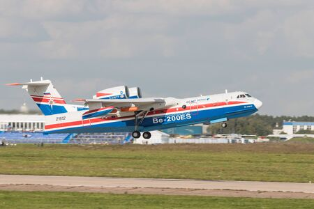 30 AUGUST 2019 MOSCOW, RUSSIA: A passenger plane taking off the runway - UAR BE-200ES 에디토리얼