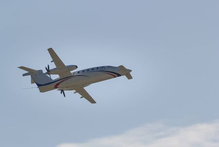 30 AUGUST 2019 MOSCOW, RUSSIA: A small passenger plane with side propellers flying in the sky