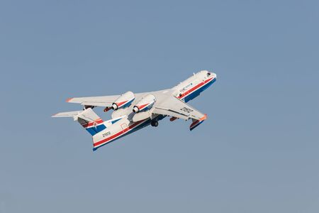 30 AUGUST 2019 MOSCOW, RUSSIA: A passenger plane flying up in the sky - UAR BE-200ES