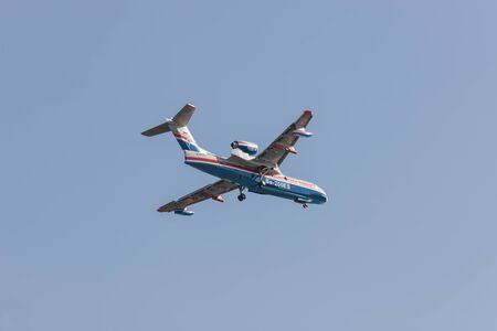 30 AUGUST 2019 MOSCOW, RUSSIA: A passenger plane flying in the blue sky - back view - UAR BE-200ES