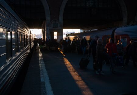 30 AUGUST 2019 MOSCOW, RUSSIA: people walking on the train station on sunset 에디토리얼