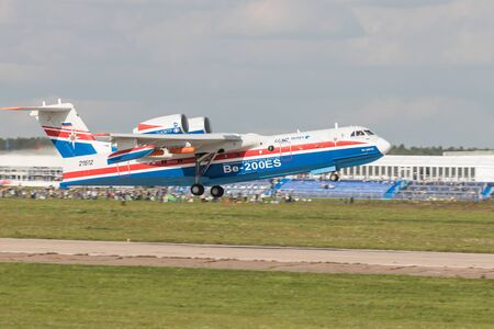 30 AUGUST 2019 MOSCOW, RUSSIA: A big passenger plane taking off the runway and speeding up - UAR BE-200ES