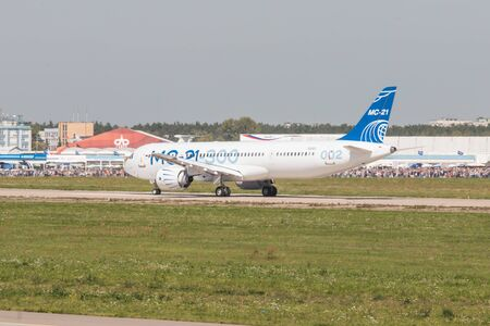 30 AUGUST 2019 MOSCOW, RUSSIA: Big passenger aircraft landed on the runway and slowing down the speed - AIRBUS MC-21 300