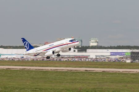 30 AUGUST 2019 MOSCOW, RUSSIA: A big white passenger plane taking off the runway - SUKHOI SUPERJET100 에디토리얼