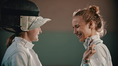 Two young fencers are looking at each other and laughing Banque d'images
