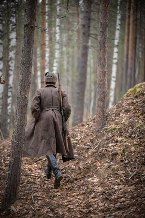 A soldier of World War II is going to the forest