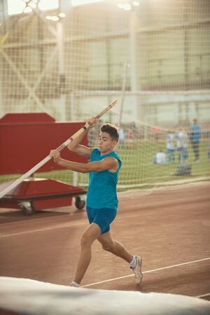 Pole vaulting training - young fit man about to jump