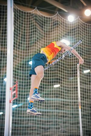 Pole vaulting - man is falling after jump with pole