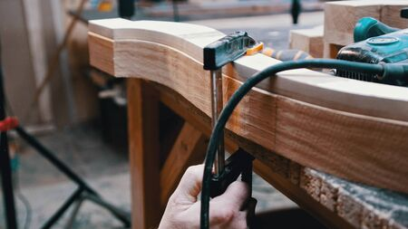 Carpentry - a man woodworker measuring the detail width