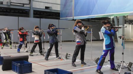 6-12-2019 RUSSIA, KAZAN: BULLET SHOOTING. girls are standing and preparing to shoot