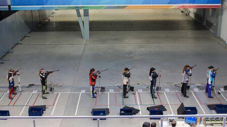 6-12-2019 RUSSIA, KAZAN: BULLET SHOOTING - young women in the shooting gallery holding guns